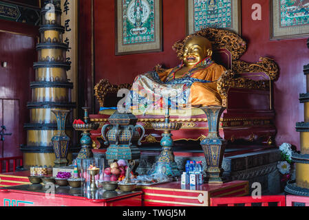Statue of Laughing Buddha in Gate Hall of Harmony and Peace in so called Lama Temple in Beijing, China - Stock Image