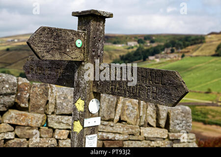 Wooden signpost pointing to Ponden Hall - the building use Emily Bronte in Wuthering Heights as both Wuthering Heights itself, and Thrushcross Grange - Stock Image