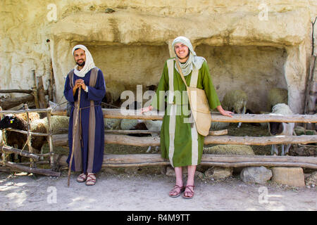 Young men in period dress at the  sheep pen in 1st century Nazareth Village Museum in Israel. This village experience is designed to give the vistor a - Stock Image
