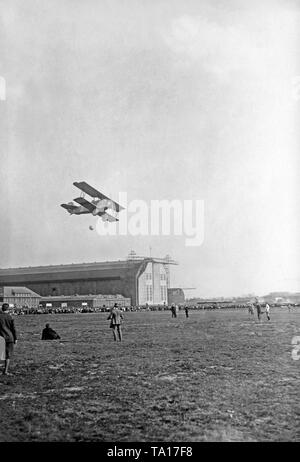A Dietrich-Gobiet biplane over the airfield Berlin-Staaken. - Stock Image