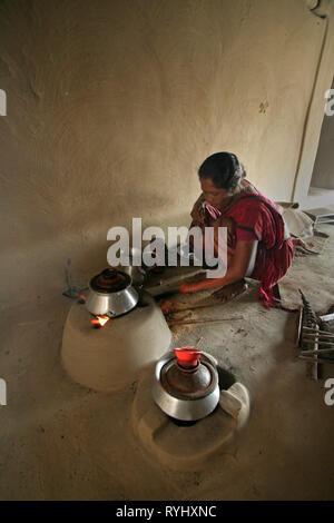 BANGLADESH Alpona Ritchil of the Garo tribal minority, making tea on a wood fire, Haluaghat, Mymensingh region photo by Sean Sprague - Stock Image