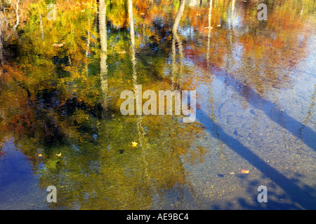 Vermont fall foliage reflecting in stream - Stock Image