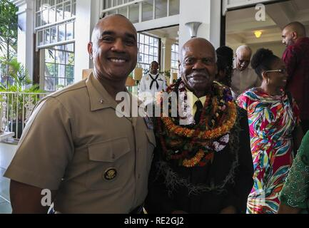 U.S. Marine Brig. Gen. Brian W. Cavanaugh, deputy commander of U.S. Marine Corps Forces, Pacific, and Dr. Ernest James Harris, Jr. stand together after a Congressional Gold Medal presentation in Honolulu Nov. 12, 2016. Harris was awarded his Congressional Gold Medal for his service as a Montford Point Marine. - Stock Image