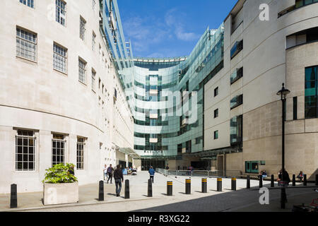 The linking building between the old BBC Broadcasting House and the new wing, designed by MacCormac Jamieson Prichard, including the main entrance. - Stock Image