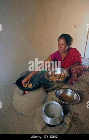 BANGLADESH Alpona Ritchil frying fish, Garo tribal minority Haluaghat, Mymensingh region photo by Sean Sprague - Stock Image