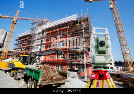 surveying instrument inside construction site - Stock Image