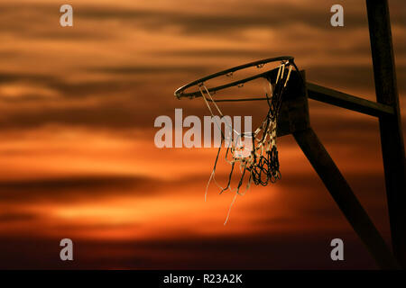 Silhouette Of Basketball Rim At Sunset - Stock Image