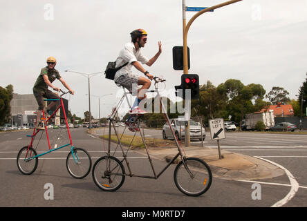 High-rise cyclists crossing the Nepean Highway, Melbourne, Australia - Stock Image