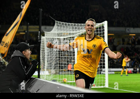 Footballer Diogo Jota celebrating a goal with young fan cheering him - Stock Image
