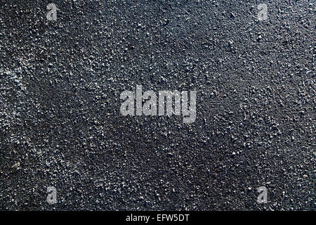 Picture of a piece of asphalt littered with salt - Stock Image