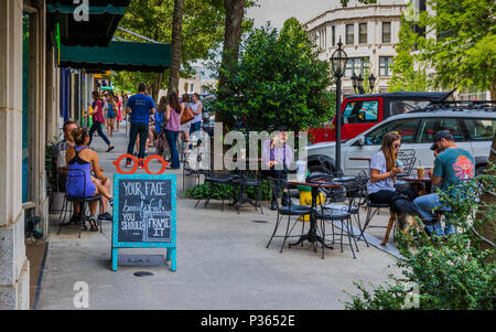 ASHEVILLE, NC, USA-10 JUNE 18:  Dining and socializing on a sunny Sunday on Battery Park Ave. - Stock Image