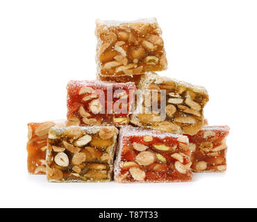 Stack of turkish delight sweets with nuts isolated on white - Stock Image