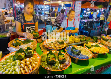 Snack stall, Night Market, next to railway station, Sathani street, Trang, Thailand - Stock Image
