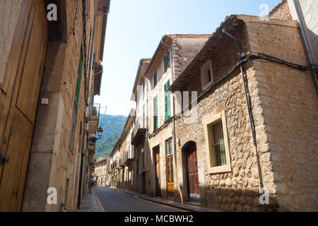 Old stone buildings line a street in the town of Soller in Mallorca, Spain. - Stock Image
