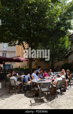 People drinking in a cafe, Bergerac town, Dordogne, France Europe - Stock Image