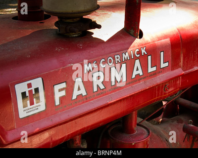 graphic tight shoot of vintage red International Harvester  Mc Cormick  Farmall Tractor - Stock Image
