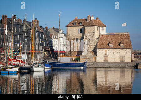 The Honfleur flag flies on La Lieutenance, situated on the harbour or Vieux Bassin at Honfleur, France. - Stock Image