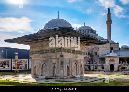 Tophane fountain, a 18th-century public water fountain built by Ottoman sultan Mahmud I and the Nusretiye Mosque, Istanbul, Turkey - Stock Image