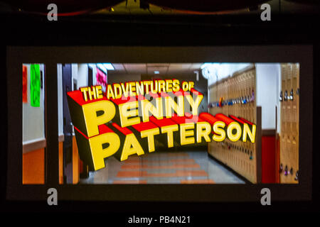 Bellmore, New York, USA. July 18, 2018. Title of comedy sci-fi The Adventures of Penny Patterson, flashes on high school hallway at start of the woman directed film, at LIIFE 2018, the Long Island International Film Expo. The movie, about a high school student facing obstacles to winning science fair when her boyfriend suddenly becomes a superhero, was nominated at LIIFE for Best Student Film, and is screening July 21 at the San Diego Comic-Con International Independent Film Festival, CCI-IFF 2018. - Stock Image