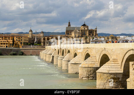 The Roman Bridge of Córdoba across the River Guadalquivir. In the back ground is Great Mosque and Cathedral. - Stock Image