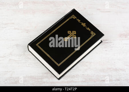 Holy Bible on white wooden background. Religion concept and faith. - Stock Image