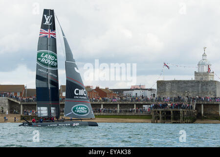Portsmouth, UK. 25th July 2015. Ben Ainslie's Landrover BAR AC45f catamaran passes the Square Tower in Old Portsmouth - Stock Image