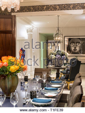 Set table in luxurious dining room - Stock Image