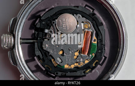 Closeup of a Citizen eco drive Wr100 wristwatch with the back removed. - Stock Image