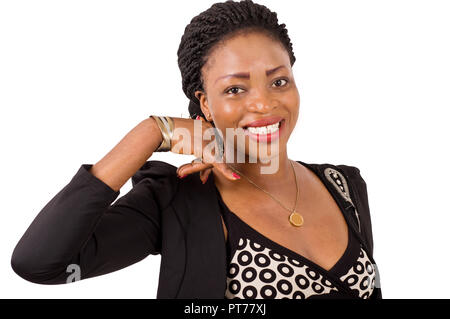 Portrait of a smiling young woman making a sign to someone isolated on white background - Stock Image
