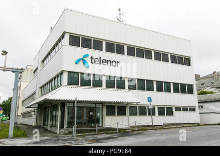 Floro, Norway, July 24, 2018: Telenor logo is displayed on the exterior of the communication service provider's office in Floro. - Stock Image