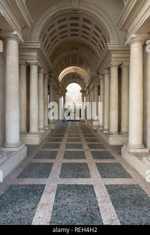 Italy Rome Galleria Spada Gallery Palazzo colonnade built with forced perspective by Francesco Borromini  in 1632 - Stock Image