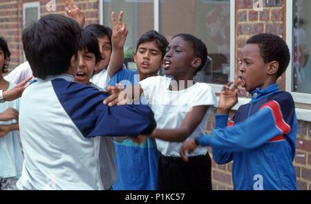 Primary school playground multi racial children arguing - Stock Image