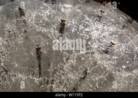 fountain looks like dandelion with splashing water, part of a dandelion fountain illuminated by the midday sun shallow DOF - Stock Image