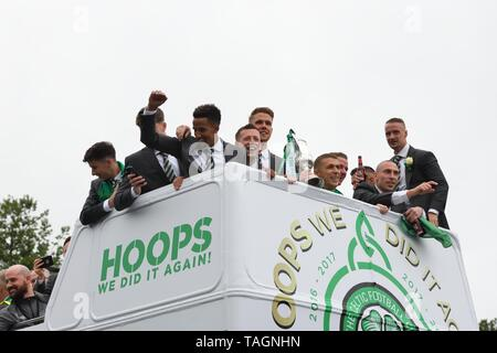 25th May, 2019. Glasgow, Scotland, UK, Europe. Scottish Cup winners, Celtic Football Club celebrate their achievement of three consecutive seasons of domestic trophy clean sweeps. The first time a domestic club has completed the triple treble in world football. Pictured are the club captain and players aboard and open top bus parade through the streets of Glasgow. - Stock Image