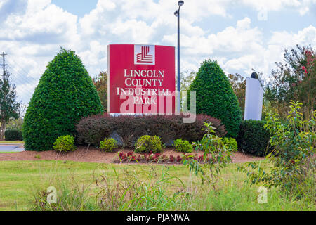 LINCOLNTON, NC, USA-9/2/18:  Sign and logo framed by shrubbery  for the Lincoln County Industrial Park. - Stock Image