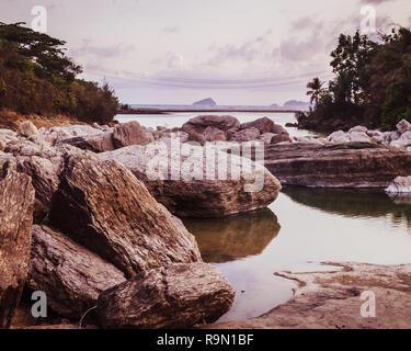 Rocks on the estuary - Stock Image