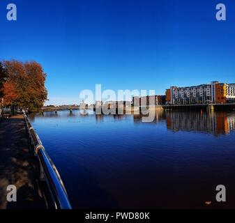 limerick city skyline ireland. beautiful limerick urban cityscape over the river shannon on a sunny day with blue skies. - Stock Image