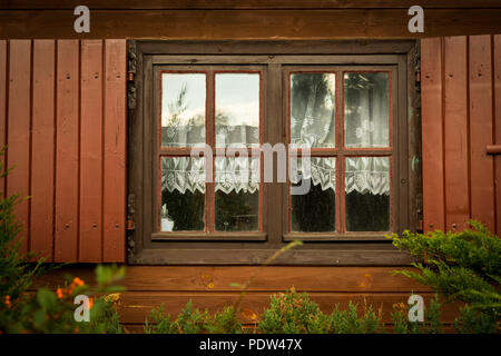 Dirty windows and shutters in the wooden house the countryside - Stock Image