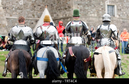 Rear View of Four Knights, demonstrating their  Horse riding skills, during an  English Heritage Jousting Tournament at Dover Castle,  August 201 - Stock Image