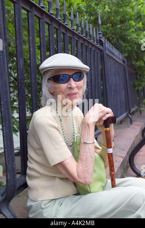 Elderly woman enjoying the Savannah, Georgia spring. - Stock Image