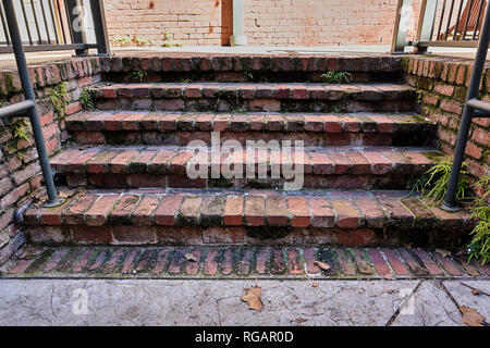 Old warn brick stairs or staircase in The Alley entertainment district of Montgomery Alabama, USA. - Stock Image