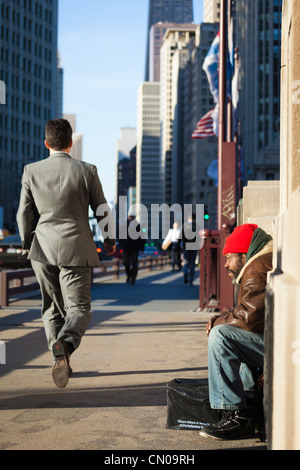 A homeless man on Michigan Avenue, Chicago - Stock Image