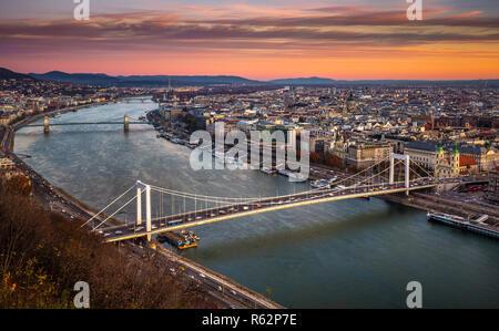 Budapest, Hungary - Elisabeth Bridge (Erzsebet hid) and Szechenyi Chain Bridge on a beautiful autumn morning with colourful clouds - Stock Image