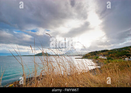 Clouds are gathering over the coast near Harstad in northern Norway. - Stock Image