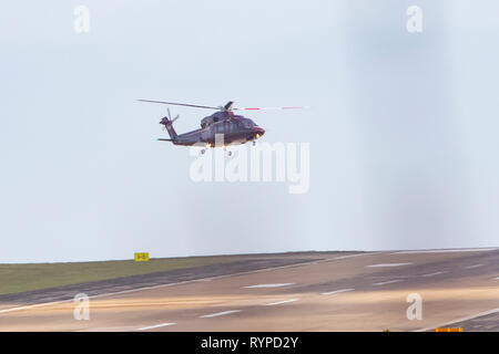 Leeds, UK. 14th Mar, 2019. The Queen's helicopter (registered G-XXEB) battled strong winds to land at Leeds Bradford Airport this afternoon. It is not known whether a member of the Royal Family was on board the helicopter but, according to the Royal Calendar, Prince Edward is carrying out official engagements in West Yorkshire today. Credit: James Copeland/Alamy Live News - Stock Image
