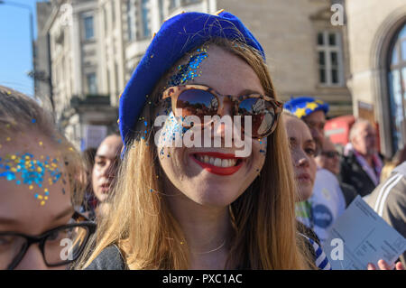 London, UK. 20th October 2018. A woman with blue and yellow glitter on her face on the People's Vote March calling for a vote to give the final say on the Brexit deal or failure to get a deal as the march leaves Hyde Park Corner. They say the new evidence which has come out since the referendum makes it essential to get a new mandate from the people to leave the EU. Peter Marshall/Alamy Live News - Stock Image