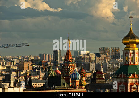 MOSCOW, AUGUST 7, 2018: Beautiful view of Moscow city and St. Basil's cathedral at summer sunset. New tall residential buildings in the background. Ho - Stock Image