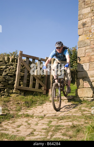 Mountain biking in the Peak District National Park Derbyshire visit tourist tourism - Stock Image