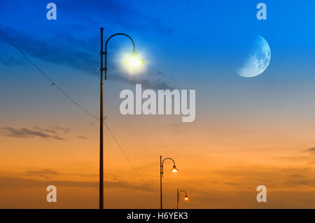 street lamps at moonlight - Stock Image