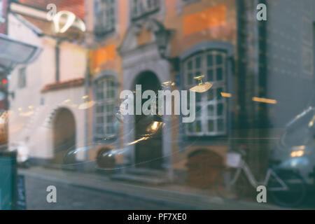 Reflection of the city in the glass of the shoe store - Stock Image